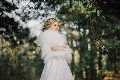 Beautiful bride woman portrait with bridal bouquet posing in her wedding day Stock Photos