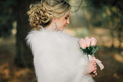 Beautiful bride woman portrait with bridal bouquet posing in her wedding day Royalty Free Stock Images