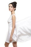 Beautiful bride woman wearing white flying dress Stock Photo