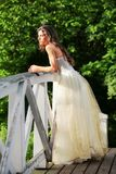Beautiful bride on the wooden bridge Stock Images