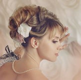 Beautiful bride with a wreath of roses. Royalty Free Stock Photo