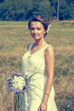 Beautiful bride. In the yellow field Royalty Free Stock Photo