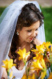 Beautiful bride and yellow flowers Stock Photography