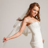 Beautiful bride. Young beautiful bride smiles charmingly Stock Photo