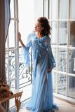 Beautiful bride young woman in a blue long peignoir in a wedding morning. Fashion beauty portrait Royalty Free Stock Photo