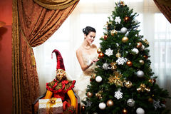 Beautiful bridenear christmas tree Royalty Free Stock Photo