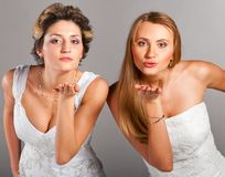 Beautiful brides is blowing kisses Stock Photos