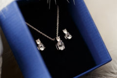 Beautiful brides necklace and earrings in flue gift box. Royalty Free Stock Photography