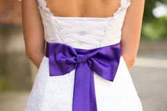 Beautiful brides wedding dress with bow. Royalty Free Stock Photography