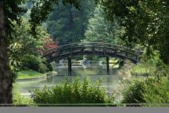 Beautiful bridge. Bridge with formal garden greenery Royalty Free Stock Images