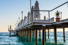 The beautiful bridge and a heavy sea in the sunny summer day Royalty Free Stock Images