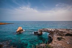 Beautiful bridge of lovers on the background of the sea in Cyprus royalty free stock photography