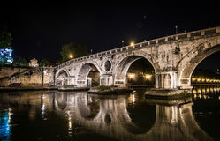 Beautiful bridge over the Tiber at night in Rome Stock Image