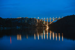 Beautiful bridge reflected in the water at night Royalty Free Stock Photo