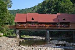 The beautiful bridge through the river. Beautiful bridge-restaurant  through the river in the Carpathian Mountains, Ukraine Stock Image