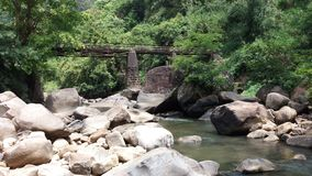 Beautiful bridge and a river with so many stones and rocks Royalty Free Stock Photos