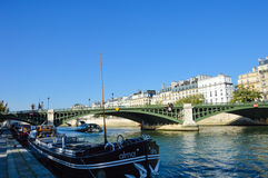 Beautiful bridge of Seine river  with docking boats - Paris Stock Images