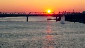 Beautiful bridges at amazing sunset with a passing stock footage