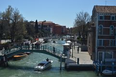 Beautiful Bridges And Boats Sailing On An Idyllic Canal In Venice. Travel, holidays, architecture. March 28, 2015. Venice, Veneto stock images