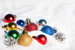 Beautiful, bright Christmas balls in snow. Stock Photo