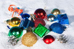 Beautiful, bright Christmas balls in snow. Stock Photography
