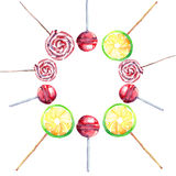 Beautiful bright delicious tasty yummy cute lovely summer dessert sweet red, pink, striped and lemon candies on a sticks located i Stock Image