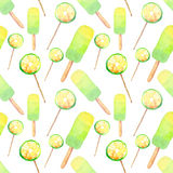 Beautiful bright delicious tasty yummy cute summer dessert fresh lime frozen juice ice cream and lemon citrus candies on a sticks Royalty Free Stock Image