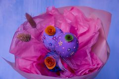 A beautiful bright Easter bouquet of three eggs royalty free stock photos