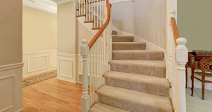 Beautiful and bright entryway with stairs. Royalty Free Stock Images