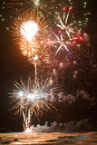 Beautiful bright fireworks over the ocean. Royalty Free Stock Image