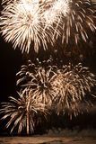 Beautiful bright fireworks over the ocean. Royalty Free Stock Photos