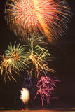 Beautiful bright fireworks over the ocean. Royalty Free Stock Images
