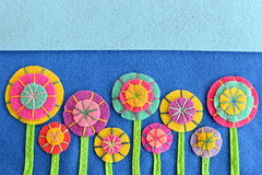 Beautiful bright flowers made of felt circles. Needlework idea. Crafts flowers embellishments. Background for greeting card for birthday, Valentine's day, Easter Royalty Free Stock Images