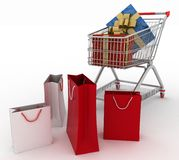 Beautiful bright gift boxes in supermarket trolley and paper bags Royalty Free Stock Images
