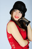 Beautiful bright girl in black hat Royalty Free Stock Images