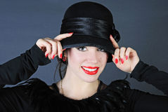 Beautiful bright girl in black hat Royalty Free Stock Image