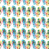 Beautiful bright lovely comfort summer pattern of beach blue yellow flip flops with tropical palm design watercolor Royalty Free Stock Images