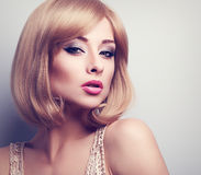 Beautiful bright makeup blond woman with short hair style lookin Royalty Free Stock Image