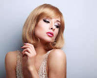 Beautiful bright makeup woman with blonde hair style looking dow Stock Photos