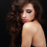 Beautiful bright makeup woman with curly brown hair Stock Photography