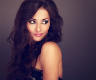 Beautiful bright makeup woman with curly long hair style looking Royalty Free Stock Photos