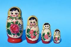 Russian Babushka Nesting Dolls on Bright Blue Background. Group of Four stock photo