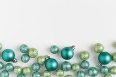 Beautiful, bright, modern Christmas holiday ornaments decorations horizontal border on white background