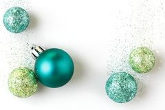 Beautiful, bright, modern Christmas holiday ornaments decorations on white background with luxe glitter effect Stock Photos