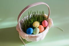 Beautiful bright picture with Easter eggs in a basket royalty free stock photos