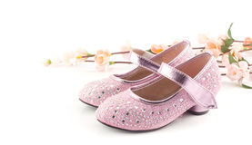Beautiful and bright  pink girl shoes on white Royalty Free Stock Image