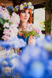 Beautiful bright red haired girl with flowers. Photo taken 08.22.2015 Royalty Free Stock Photography