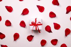 Beautiful bright red rose petals on solid white background. Happy valentines day oliday sales concept. Romantic gesture, love confession, happy valentines day Royalty Free Stock Photos