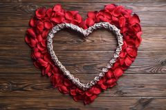 Beautiful bright red rose petals on wooden background. Happy valentines day oliday sales concept. Romantic gesture, love confession, happy valentines day Royalty Free Stock Photos