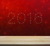 2016 from beautiful bright stars over empty wooden table and red. Blur light with shiny starry, New year background Stock Illustration
